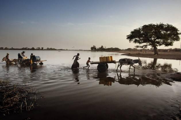 Pianeta Migranti.  Oxfam solo 1 centesimo al giorno per l'emergenza climatica nei Paesi poveri.