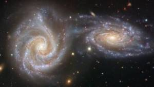 Galassie nell'Universo primordiale in sistemi in fase di fusione